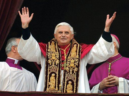 Pope Benedict XVI greets the crowd from the central balcony of St. Peter's Basilica moments after being elected, in this April 19, 2005, photo.