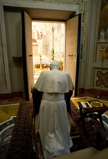 In this photo provided by the Vatican newspaper L'Osservatore Romano, Pope Benedict XVI kneels in prayer at the end of a weeklong spiritual retreat, at the Vatican, on Saturday.