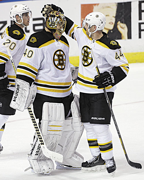 NICE JOB: Boston Bruins goalie Tuukka Rask (40) and Dennis Seidenbery (44) celebrate after their 4-1 win over the Florida Panthers on Sunday in Sunrise, Fla. Rask made 34 saves to earn the victory.
