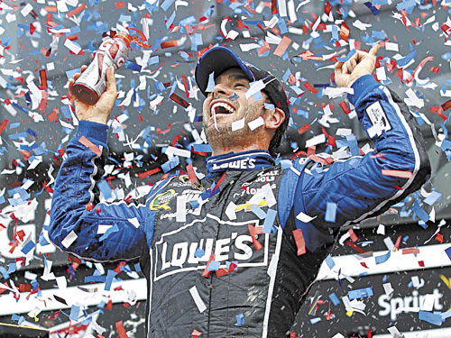 TWO-TIME CHAMP: Jimmie Johnson celebrates after winning the Daytona 500 on Sunday at Daytona International Speedway in Daytona Beach, Fla. It was the second Daytona 500 win for the NASCAR driver.