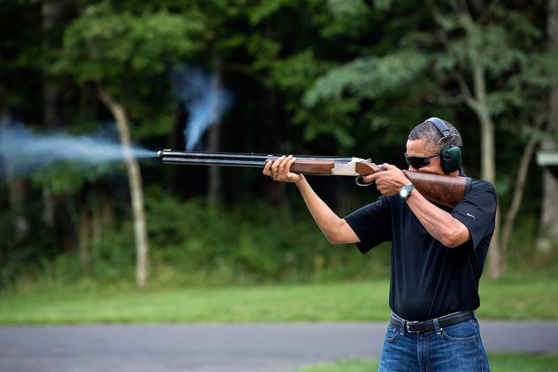 President Obama shoots clay targets on the range at Camp David, Md., on Aug. 4, 2012, in this photo released by the White House on Saturday, two days before the president heads to Minnesota to talk about gun-control initiatives.