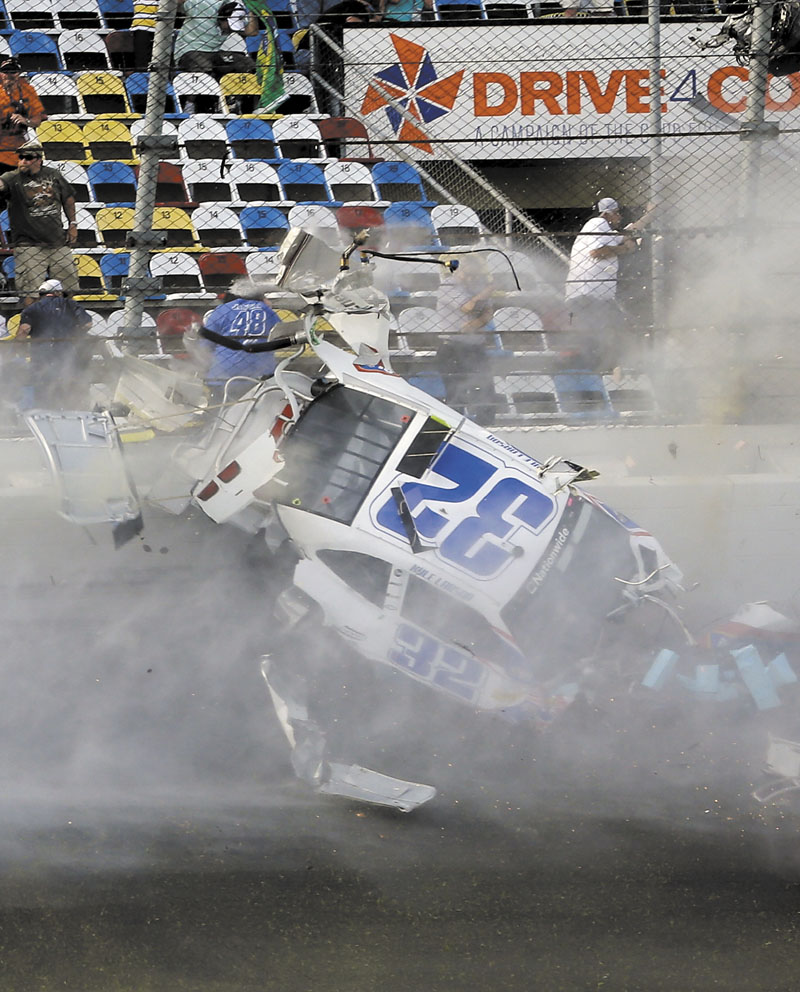 BIG CRASH: Kyle Larson crashes into the catch fence in a multi-car crash on the final lap of the NASCAR Nationwide Series on Saturday at Daytona International Speedway, Saturday in Daytona Beach, Fla.