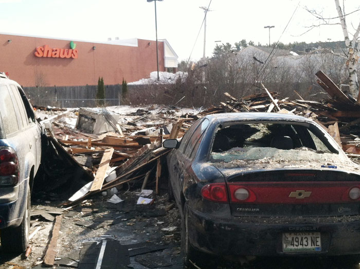 Debris and damaged vehicles from this morning's explosion at 29-31 Bluff Road, which is adjacent to Shaw's supermarket.