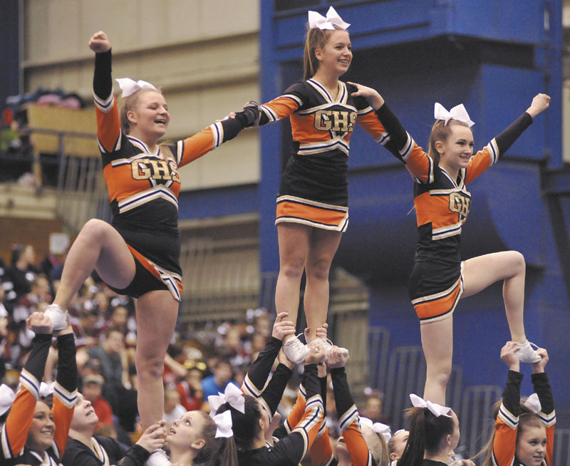 PUTTING ON A SHOW: Gardiner Area High School performs its routine during the Class B cheering state championships at the Bangor Auditorium on Monday.