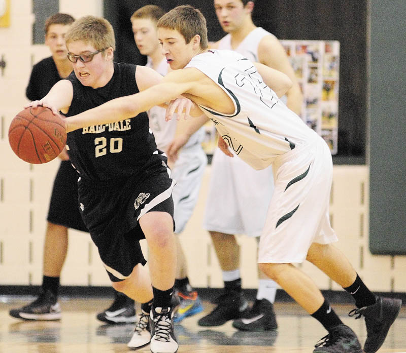 Winthrop's Dakota Carter, right, steals the ball away from Hall-Dale's Brian Allen during a game on Thursday February 7, 2013 at Winthrop High School.