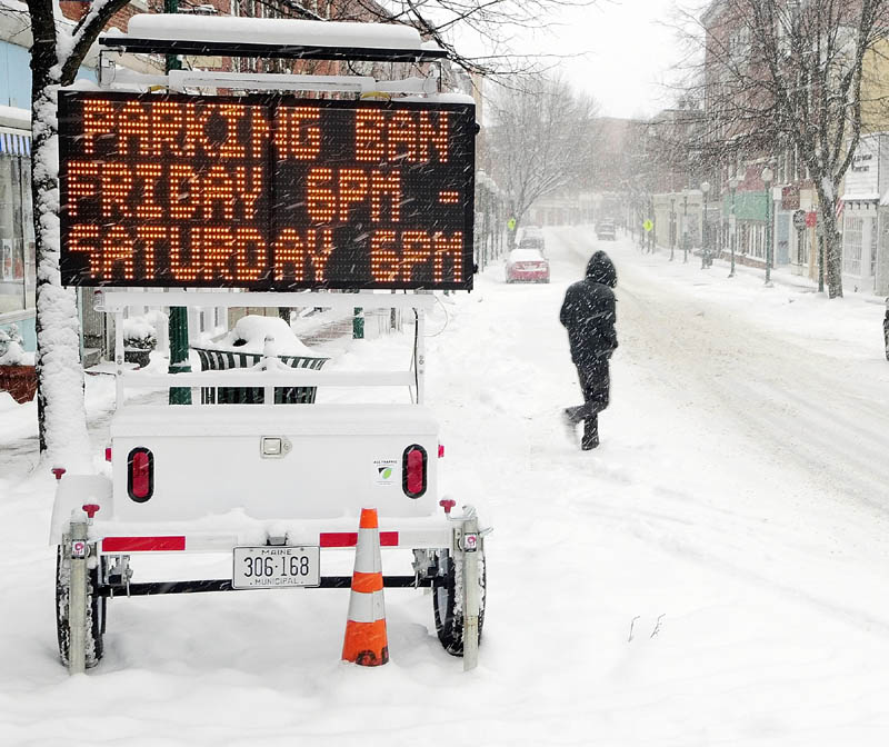 A flashing sign on Water Street announces the parking ban on all streets in the city of Gardiner starting at 6 pm. on Friday.