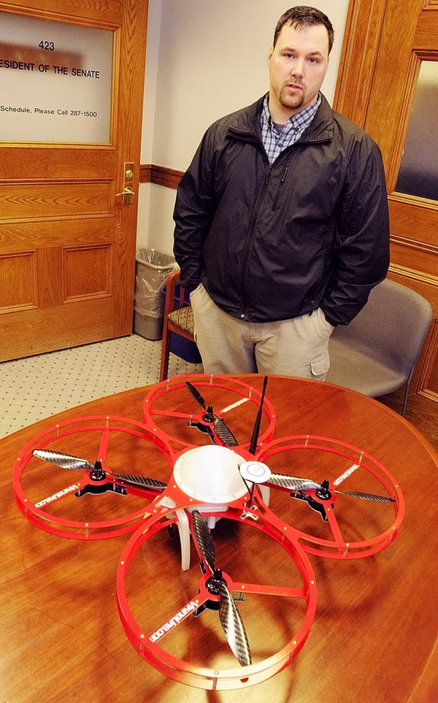 "Christopher Taylor, president and drone designer for Viking Unmanned Aerial Systems, of Limington, talks about his company's FR-Xtreme drone model, which is on table, on Tuesday at the State House in Augusta.The company's website calls it a ""Vertical Take-Off and Landing Commercial Quad Copter built to serve multiple industries."""