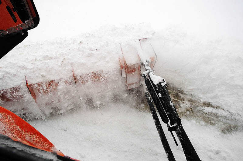 Snow flies of the wing plow on the side of the truck driven by Augusta Public Works plow truck driver Stan Moore on Saturday.