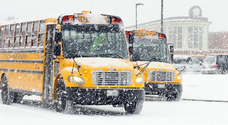 Buses leave Cony High School at 10:45 a.m. on Friday as students were released early for the winter storm in Augusta.