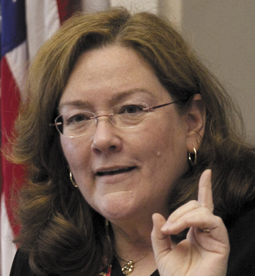 In this 2012 file photo, Maine Chief Justice Leigh Saufley gestures during her annual State of the Judiciary address at the State House in Augusta, Maine. Large caseloads, aging courthouses and antiquated technology challenge the state's judicial system, but the courts are addressing those issues, she said Thursday, Feb. 21, 2013. (AP Photo/Robert F. Bukaty)