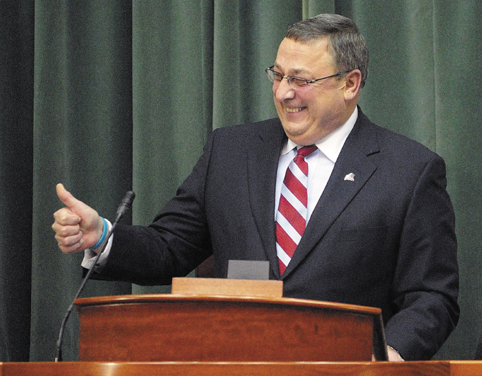 Gov. Paul LePage gestures near the end of his first State of The State address, to a joint convention of the Maine House and Senate, in January 2012.