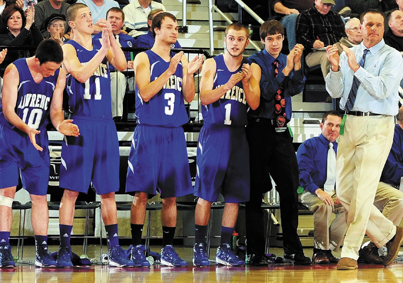 Lawrence coach Mike McGee, right, and the bench cheer on the Bulldogs late in fourth quarter of a 49-41 win over Edward Little in an Eastern Class A semifinal at the Augusta Civic Center.