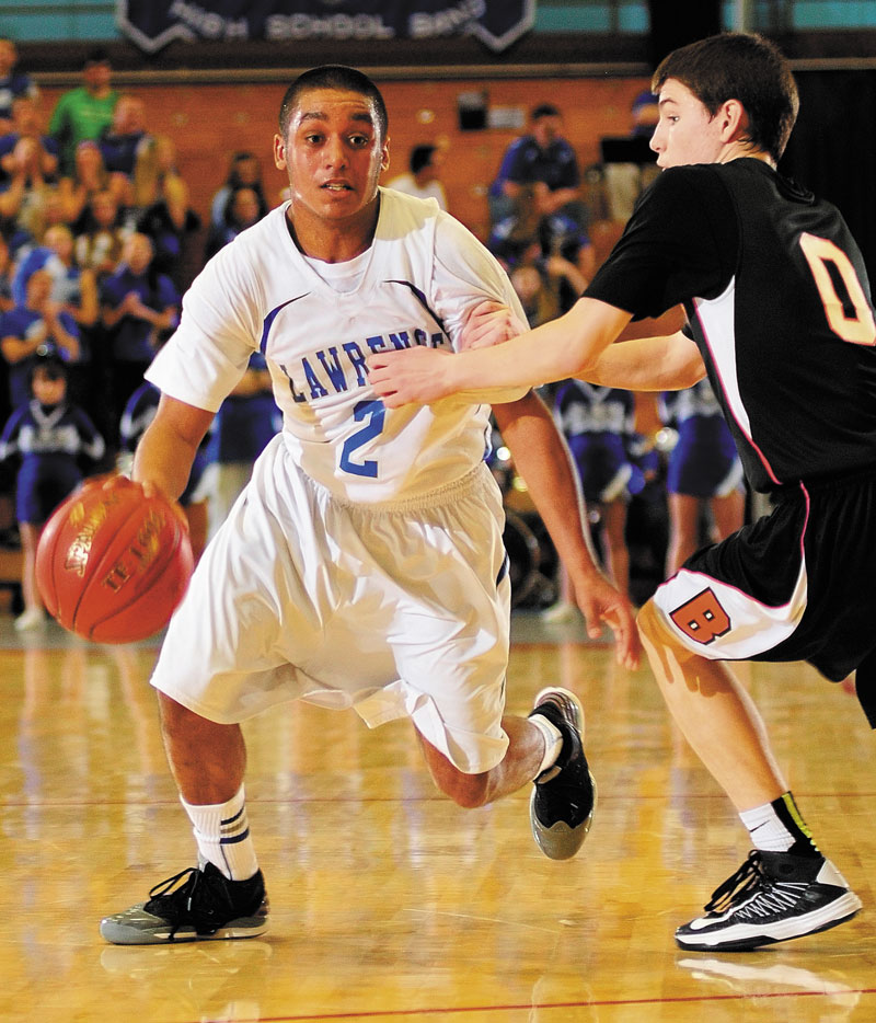 Lawrence's Xavier Lewis tries to dribble past Brunswick's Blake Gordon during an Eastern Class A tournament game on Saturday February 16, 2013 at the Augusta Civic Center.