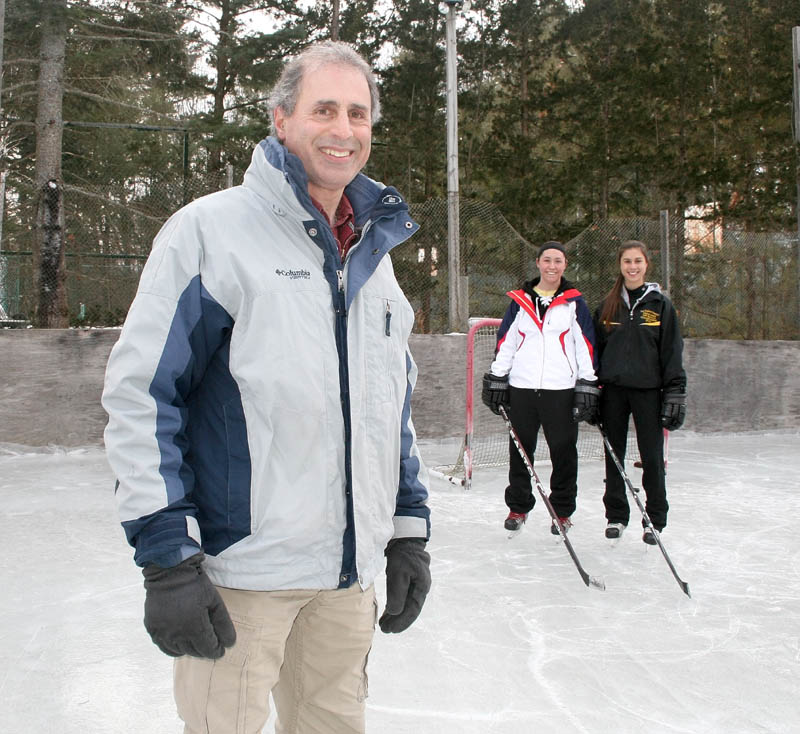 Mike Nawfel built a ice rink in his backyard in Waterville for his daughters and their friends.