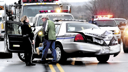 Fairfield police officer William Beaulieu cruiser after it collided with a tractor trailer truck on U.S. Route 201 in Fairfield in January.