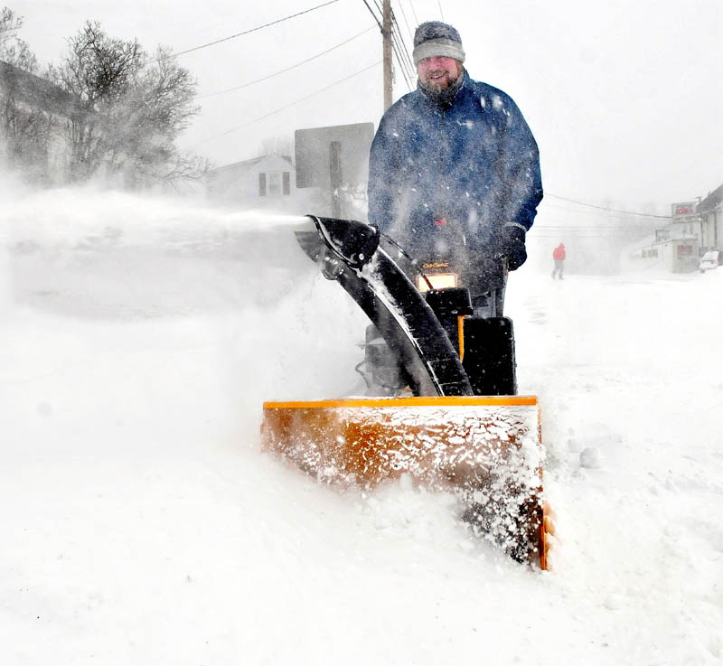 Luke Schaedle uses his snowblower as he tries to keep up with the snow storm that was near blizzard conditions at his home in Benton on Saturday.
