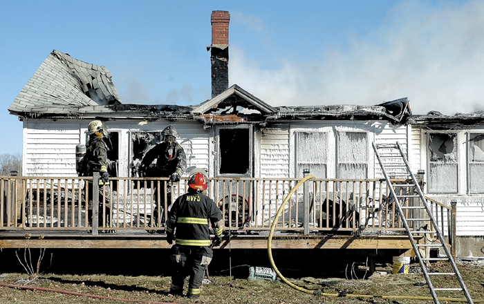 Smoke lingers over the remains of Bonnie and Darrell Gilbert's home after it was destroyed by fire Thursday in St. Albans.