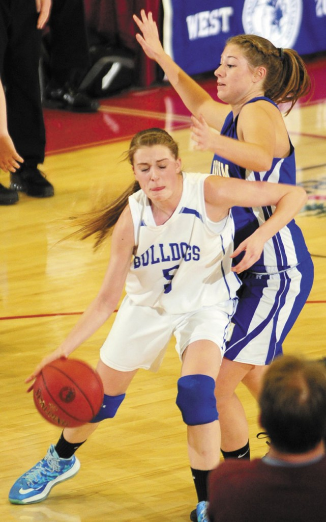 Madison's Bronte Elias, left, drives around Mt. Abram's Tori Beane during an Western Class C tournament game on Tuesday February 19, 2013 at the Augusta Civic Center.