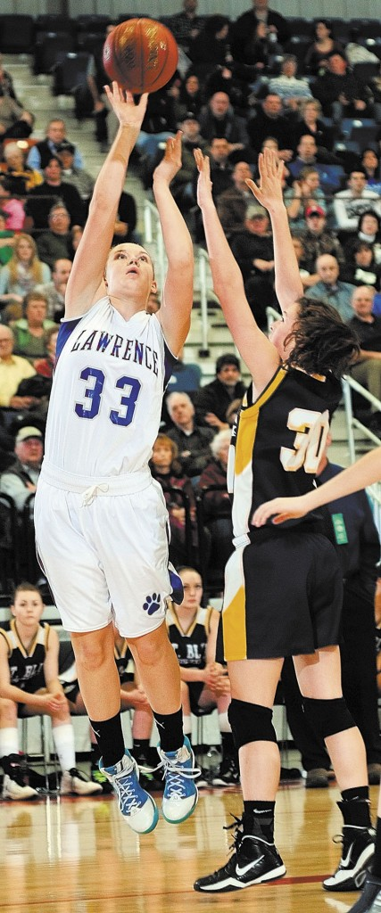 Staff photo by Joe Phelan Lawrence's Nia Irving shoots over Mt. Blue's Miranda Nicely during an Eastern Class A tournament game on Friday February 15, 2013 at the Augusta Civic Center.