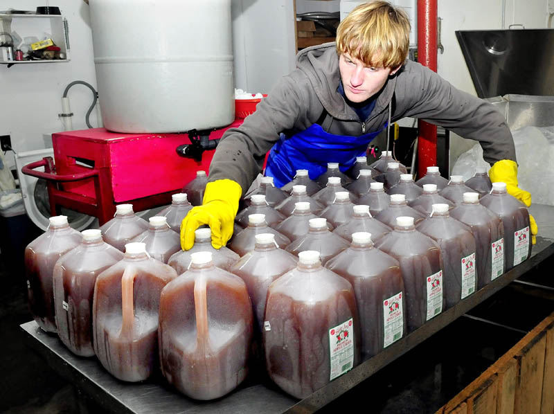 Bartley Hinson bottles cider, which was recently pressed at The Apple Farm in Fairfield on Wednesday. The apples harvested last fall have been in cold storage and produce a sweeter tasting cider.