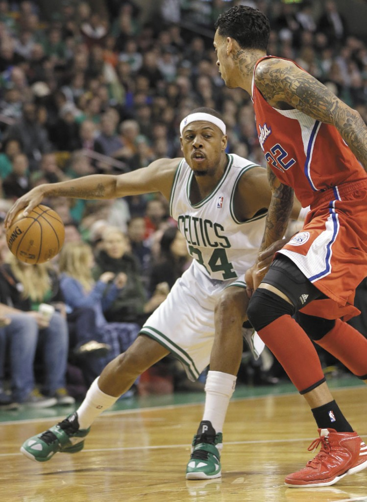 MAKE A MOVE: Boston's Paul Pierce, left, looks for an opening around Los Angeles' forward Matt Barnes in the fourth quarter of the Celtics' 106-104 win Sunday at the TD Garden in Boston.
