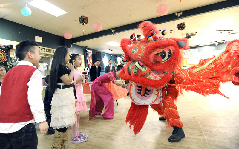 Children watch the dragon dance during the celebration of the lunar new year hosted by the Vietnamese American Association of Maine in Portland on Saturday.