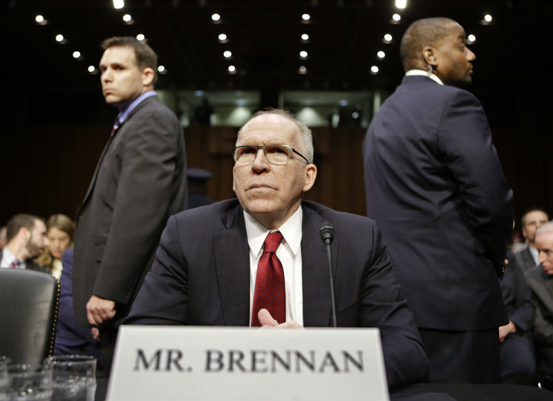 CIA director nominee John Brennan, flanked by security, prepares to testify at his confirmation hearing before the Senate Intelligence Committee on Thursday.