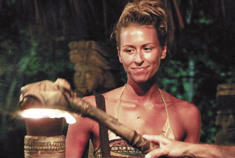 """Ashley Underwood, who grew up in Benton, watches as her torch is extinguished, signaling her removal from the game show """"Survivor,"""" in 2011."""