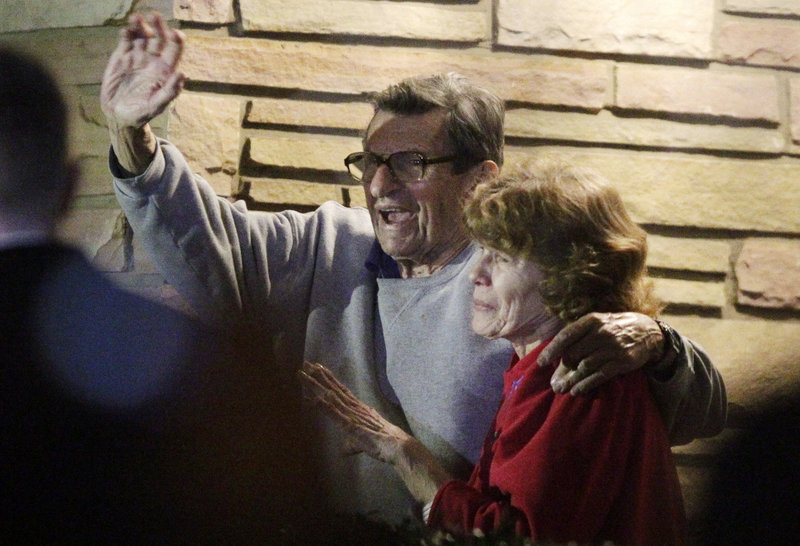 Joe Paterno and his wife, Sue, thank supporters outside their home in State College, Pa., on Nov. 9, 2011. He was fired as Penn State's coach in a late-night phone call that month, after his assistant was arrested on sex-abuse charges, and died in January 2012 at age 85.