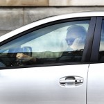 A driver talks on his cellphone while driving on Portland's Congress Street on Wednesday, Feb. 13, 2012.