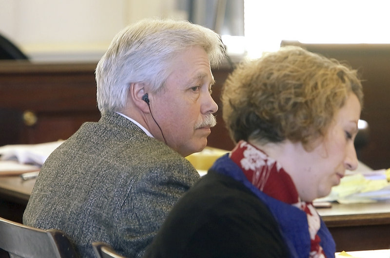 Defendant Mark Strong Sr. listens to questions asked during a motion hearing at York County Superior Court in Alfred on Friday, February 22, 2013. At right is his co-counsel Tina Nadeau.