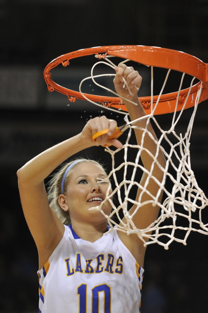 Kari Eldridge snips at the net Saturday after Lake Region downed York 50-24 to win Western Class B.