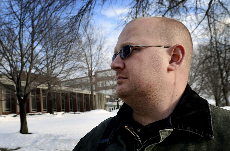 Veteran Chris Kotch on campus Monday at the University of Southern Maine in Portland, where he is taking classes. Scars can be seen along his neck from injuries sustained while serving in Iraq while in the Army Reserves.