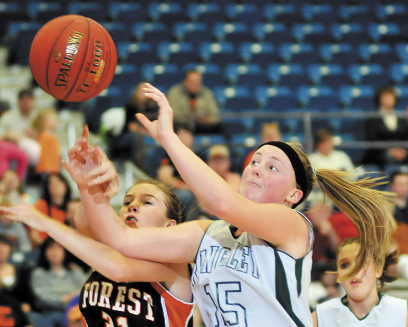Rangeley's Taylor Esty, right, goes up for a shot against Anna Carrier of Forest Hills in a Western Class D semifinal Thursday at the Augusta Civic Center. Rangeley won, 59-43.