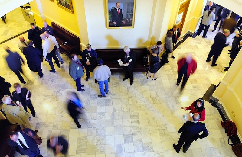 In this file photo, people move through the third floor between the House and Senate chambers at the State House in Augusta. The Maine Legislature's budget-writing committee made progress Thursday on an emergency spending plan to fix Maine's $153 million budget shortfall.
