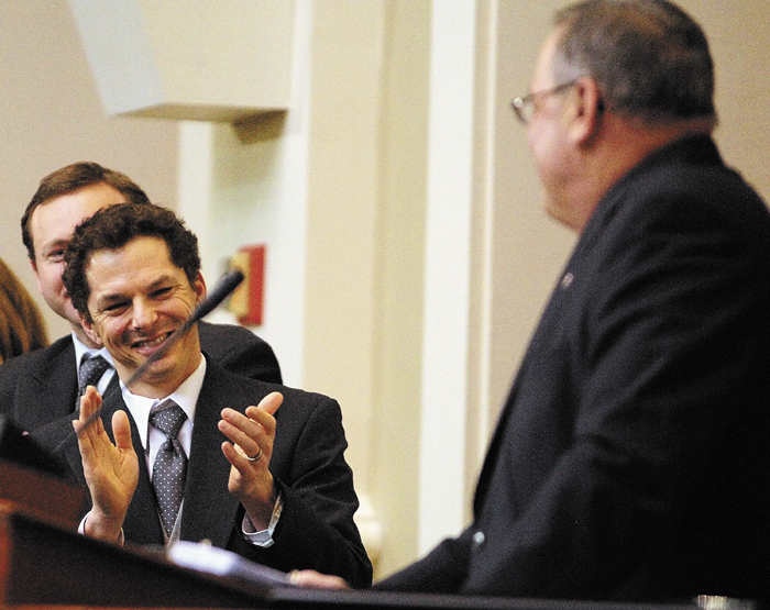 Staff photo by Joe Phelan Senate President Justin Alfon, left, claps during Gov. Paul LePage's State of the State address on Tuesday February 5, 2013 in the State House in Augusta.