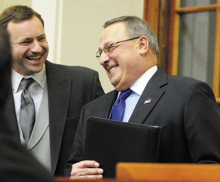 "Gov. Paul LePage, right, chats with Maine Speaker of the House Mark Eves, left, before the governor gives the State of the State address on Tuesday February 5, 2013 in the State House in Augusta. A conservative think tank says Gov. Paul LePage's two-year budget contains a ""subtle tax increase,"" despite LePage's pledge to not raise taxes."