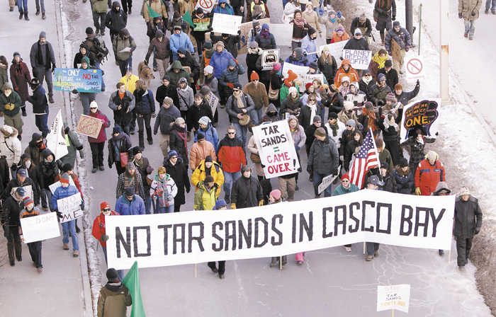 People march to the Maine State Pier in Portland on Jan. 26 to attend a rally protesting the use of the Portland to Montreal pipeline to send tar sands crude oil to Casco Bay.