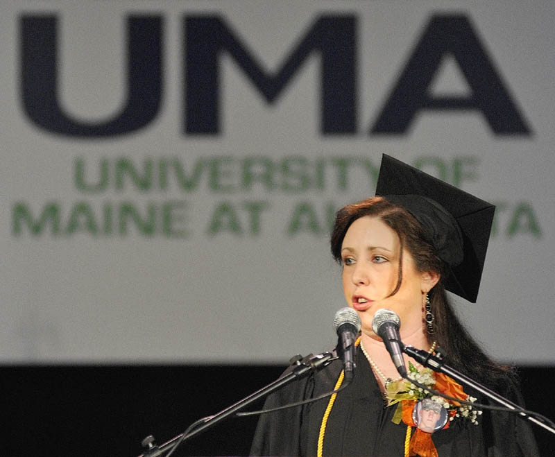 Stephanie Pooler, of Waterville, who received a bachelor of science degree in mental health and human services, speaks during the University of Maine at Augusta commencement in May 2011 at the Augusta Civic Center. A new funding plan for the state's universities will reward the Augusta and Farmington campuses if they continue to successfully graduate students.