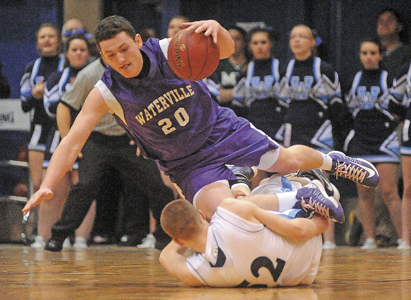 Waterville's Josh Gormley is tripped by Presque Isle's Bradley Shields in the second half of their Eastern Class B quarterfinal Saturday. Presque Isle won, 47-45.