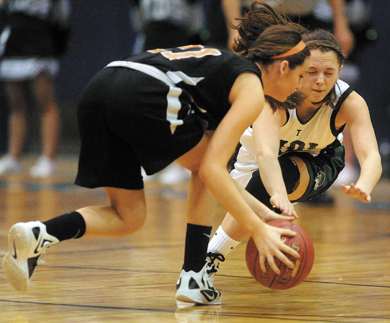 Winslow's Delaney Wood, left, and Mt. Desert Isle's Molly Carroll go after a loose ball in their Eastern Class B quarterfinal Saturday. MDI won, 38-31.