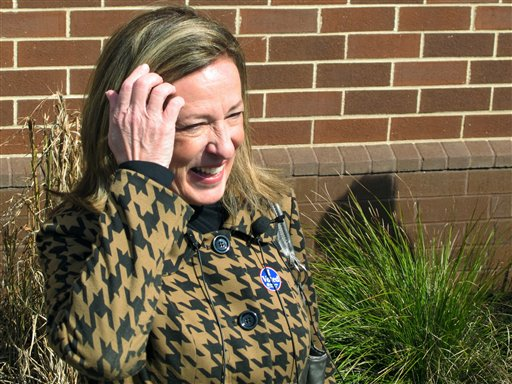 Elizabeth Colbert Bush, the sister of comedian Stephen Colbert, talks to reporters after voting in Mount Pleasant, S.C., on Tuesday.