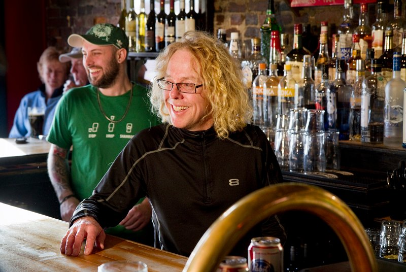 Brian Boru co-owner Daniel Steele, at right, chats with patrons from behind the bar of the Portland Irish Pub on Friday, March 8, 2013.