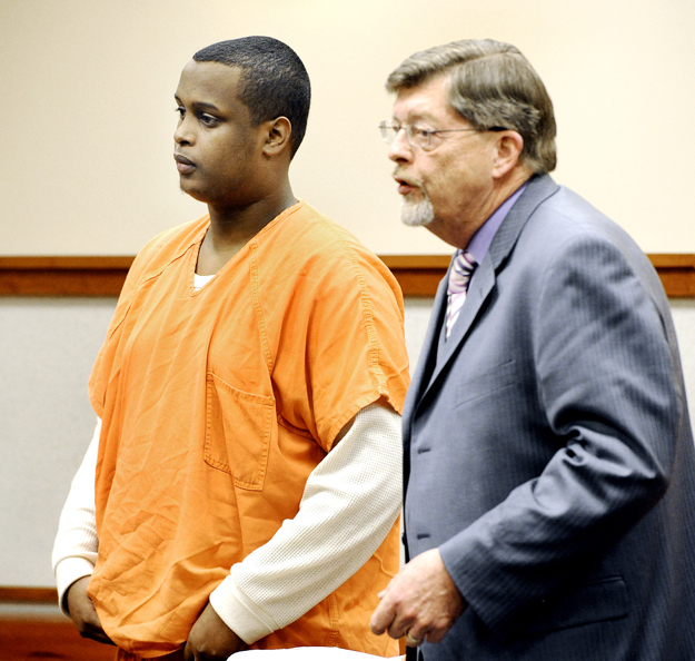 A bail reduction was denied for Mohammed Abdi, shown here with his attorney Clifford Strike in Cumberland County Unified Criminal Court on Tuesday.