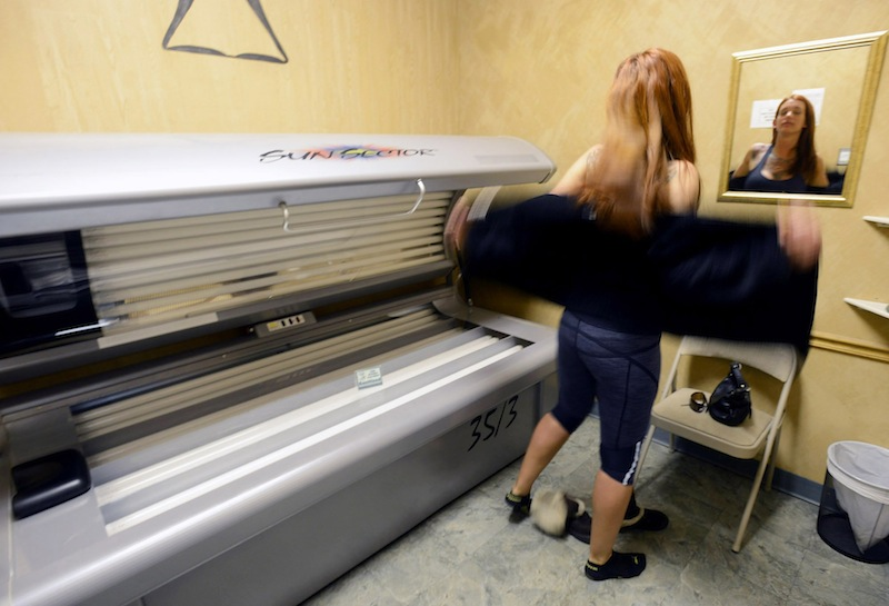 Hillary Cooledge, 28, of Portland, prepares to use a tanning bed at Sun Tiki Tanning in Portland on Thursday, March 28, 2013. Proponents say a proposed law to ban underage tanning would prevent harm to young people, but salon owners say the measure would hurt business.