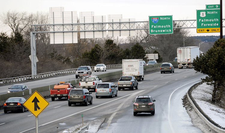 Traffic merges onto Interstate 295 north from Baxter Boulevard in Portland recently. Under the bill pending before the Legislature's Transportation Committee, the state could increase the interstate's speed limit following engineering and safety reviews.