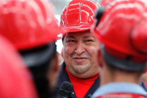 In this file photo released by Miraflores Press Office, Venezuela's President Hugo Chavez speaks with workers as he visits a truck factory in Barinas, Venezuela on Tuesday Feb. 21, 2012. Venezuela's Vice President Nicolas Maduro announced on Tuesday, March 5, 2013 that Chavez has died. Chavez, 58, was first diagnosed with cancer in June 2011. (AP Photo/Leslie Mazoch)