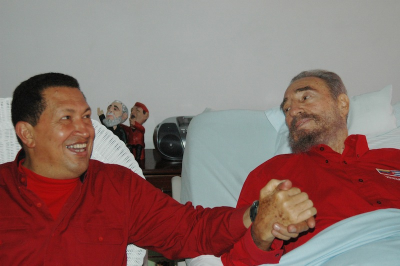 In this Aug. 13, 2006 file photo released by Cuba's Communist daily newspaper Granma, Cuba's leader Fidel Castro, right, and Venezuela's President Hugo Chavez hold hands as Castro recuperates from surgery in Havana, Cuba. Venezuela's Vice President Nicolas Maduro announced on Tuesday, March 5, 2013 that Chavez has died at age 58 after a nearly two-year bout with cancer. (AP Photo/Granma, File)