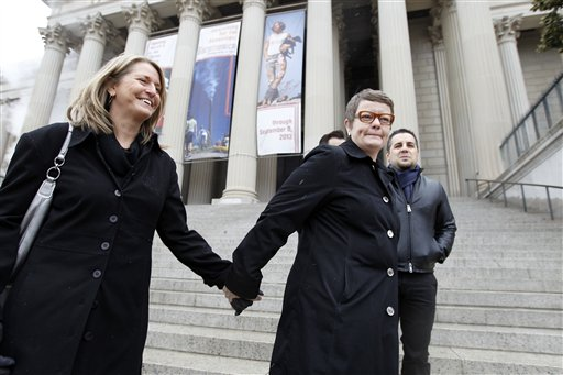 Sandy Stier, left, and Kris Perry of Berkeley, Calif., stand outside the National Archives in Washington on Monday, before going inside to view the U.S. Constitution, a day before their same-sex marriage case is argued before the Supreme Court.