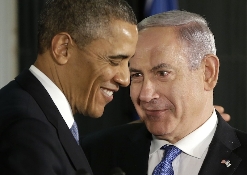 President Barack Obama and Israeli Prime Minister Benjamin Netanyahu huddle during their joint news conference in Jerusalem, Israel, Wednesday, March 20, 2013. (AP Photo/Pablo Martinez Monsivais)
